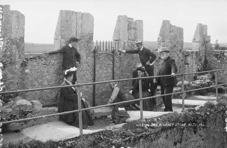 Kissing the Blarney Stone (1897). Image Source: National Library of Ireland on The Commons, Flickr