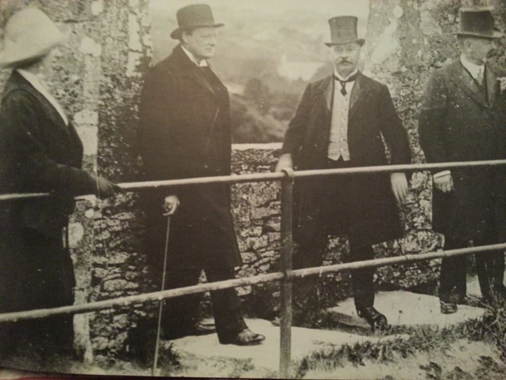 British Primeminister & renowned orator, Winston Churchill, at the Blarney Stone. Image Source: /oldphotosofcork.wordpress.com